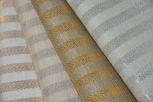gorgeous rendition of the herringbone motif handwoven with a bit of glam.  available in four classic shades; ivory/gold; oatmeal/silver; olive/gold & pearl gray/silver